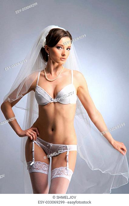 Young sexy bride in erotic lingerie