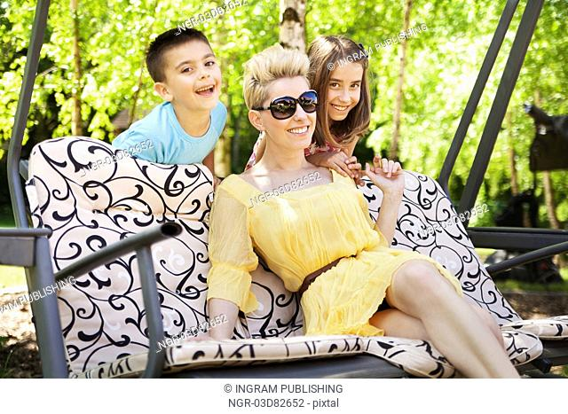 Happy family relaxing during sunny holidays