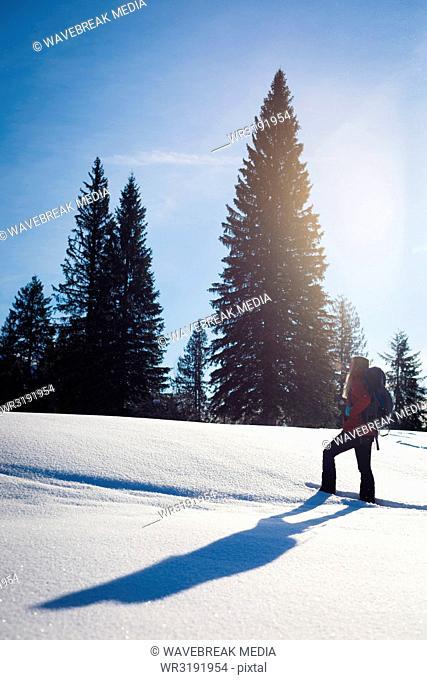 Woman walking on snowy slope