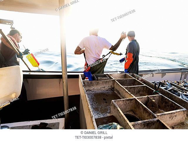 Fishermen working on boat