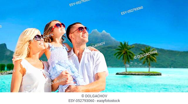 tourism, travel and family concept - happy mother, father and daughter over bora bora background