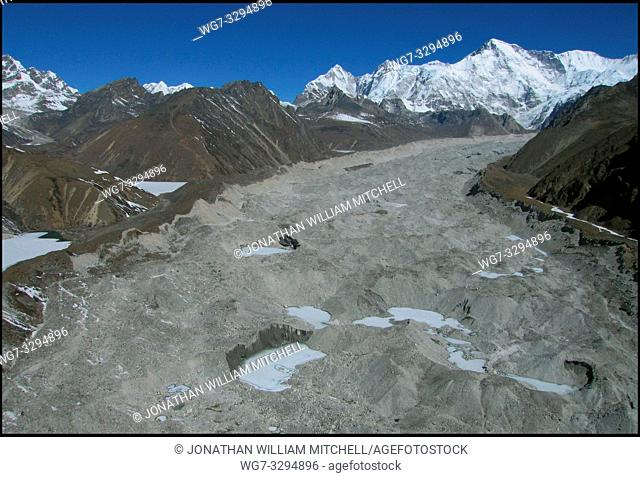 NEPAL Ngozumpa Glacier -- 16 Apr 2005 -- An aerial view of the main Ngozumpa (Gokyo) glacier. Mount Gyachung Kang is visible in the upper right Scientists have...