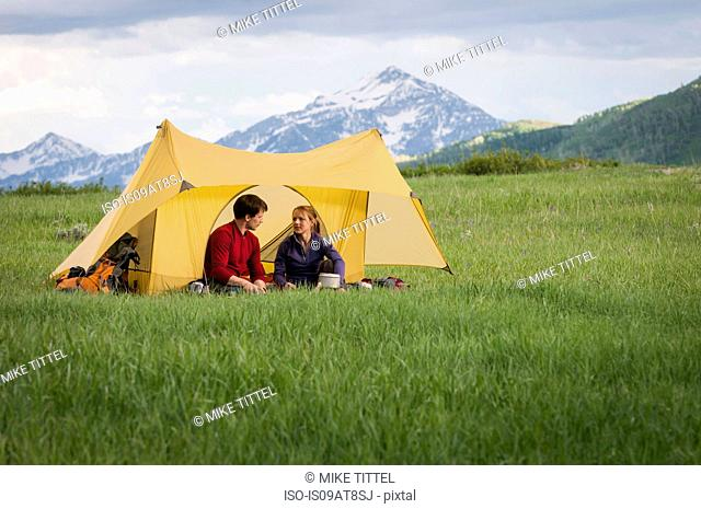 Campers on backpacking trip hanging out, Uinta National Forest, Wasatch Mountains, Utah, USA