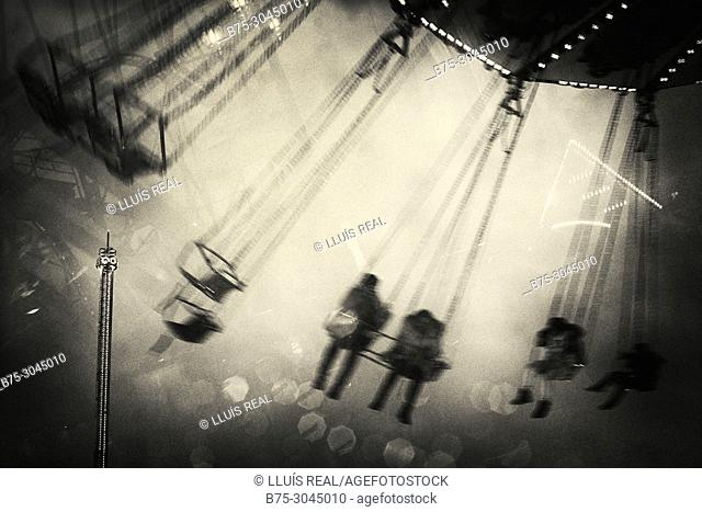 Close-up of Chair Swing ride with unrecognizable people in motion. Winter Wonderland, Hyde Park, London, UK, Europa