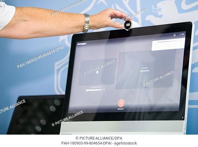 """03.09.2018, Baden-Württemberg, Stuttgart: During the presentation of the model project """"""""Telemedicine in Prisons"""""""", a nurse activates the camera of a computer..."""