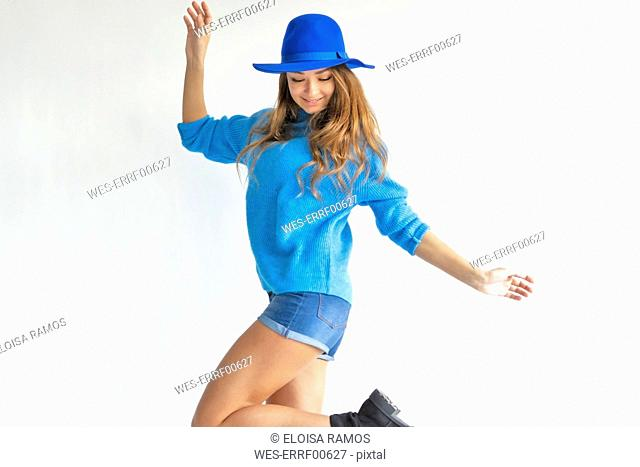 Young woman, dressed in blue, dancing