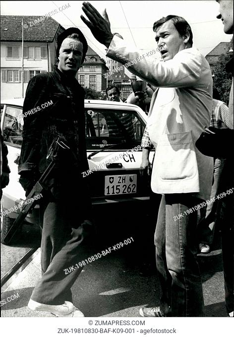 Aug. 30, 1981 - Explaining the action: French movie director Yves movie director Yves Boisset explains the action to unidentified actor during the shooting of...