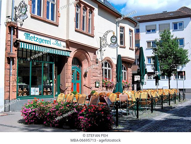 Butcher's shop Zach and earthy pub 'Zum Hawwerkasten' near the new castle in Giessen at a summer day