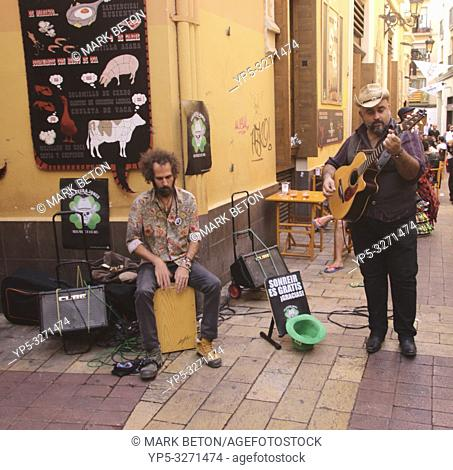 Street musicians in Calle de la Libertad Zaragoza Spain