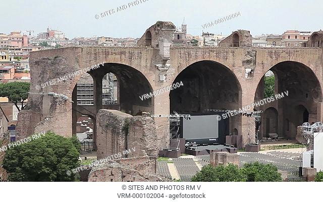 PAN, HA. Daylight. View from the Palatine Hill. Exterior: Basilica of Maxentius. Construction began on the northern side of the forum under Emperor Maxentius in...