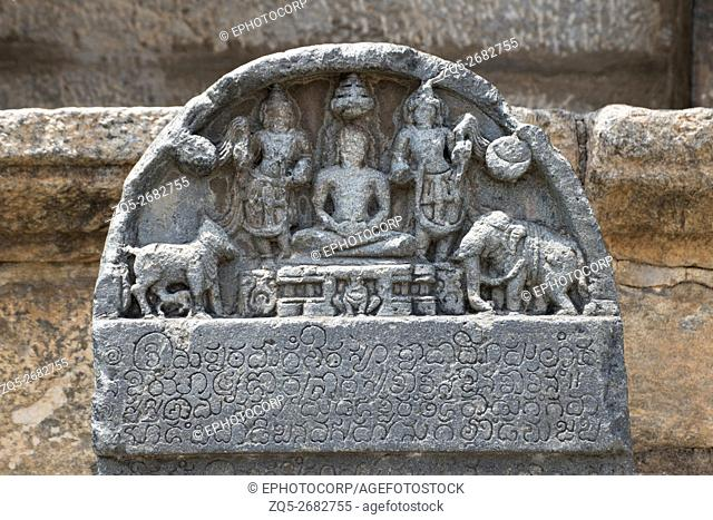 Carved inscriptions in Kannada on the stone pillar at the entrance of Parshvanatha Basadi, Basadi Halli, Karnataka, India