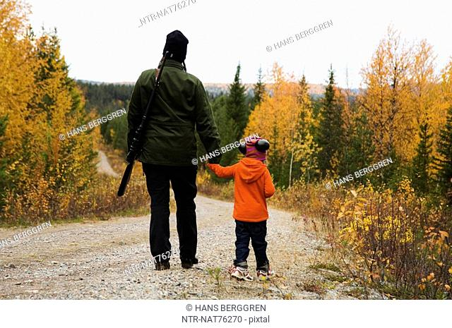 A woman and a child hunting, Sweden