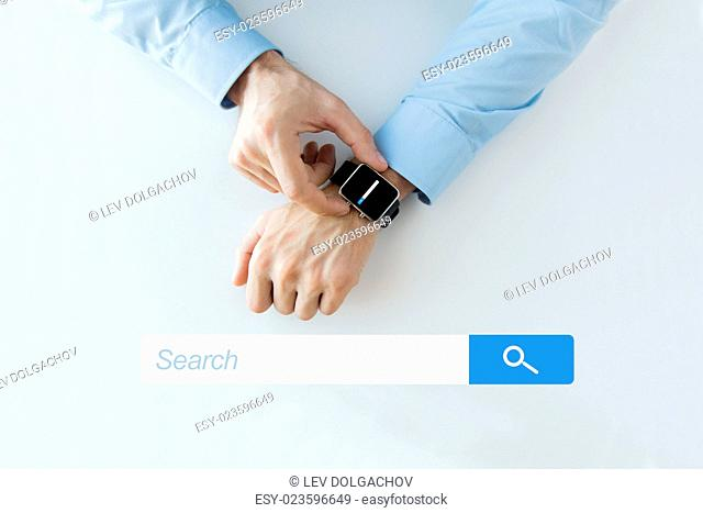 business, technology, and people concept - close up of male hands setting smart watch with web browser empty search bar on screen