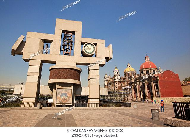 View to the Carillon, cross-shaped image symbolizing the cosmos called Nahui-Ollin and the Old Basilica de Santa Maria de Guadalupe, Mexico City, Mexico