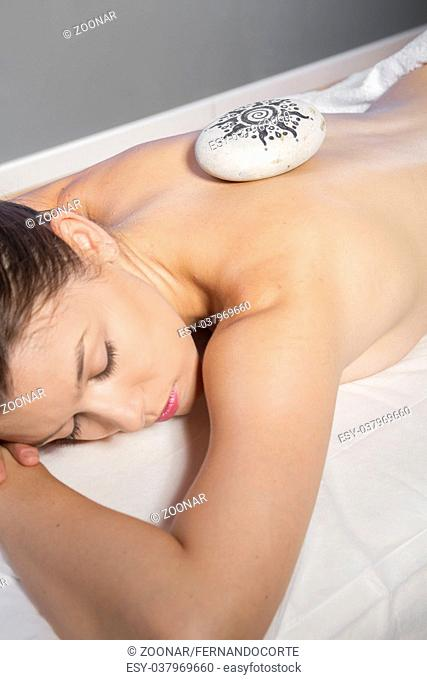 massage, beautiful woman lying on a stretcher receiving treatment relaxing
