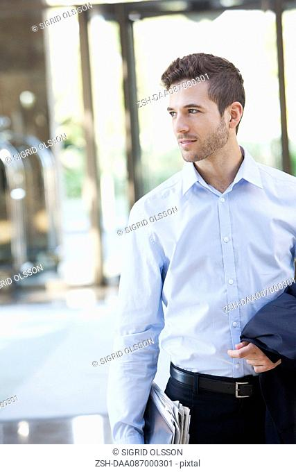Businessman on the move, portrait