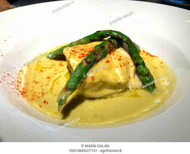 Hake loin with green sauce and asparagus