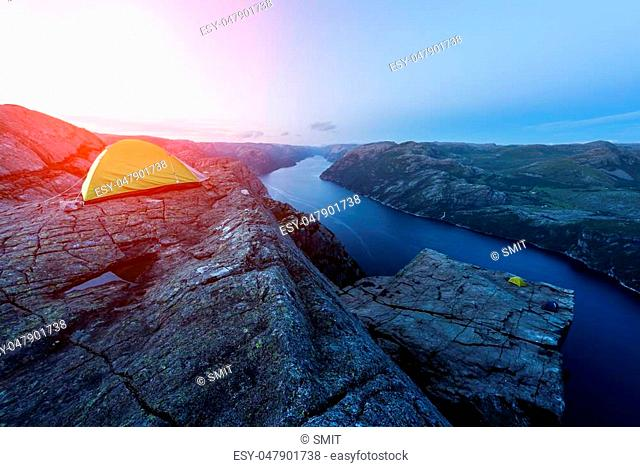 Colourful sunrise on Preikestolen (pulpit-rock) - famous tourist attraction in the municipality of Forsand in Rogaland county, Norway