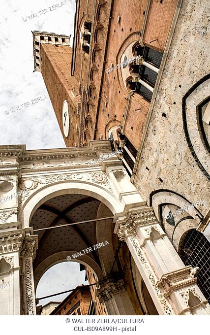 Architectural detail of Torre del Mangia, Siena, Italy