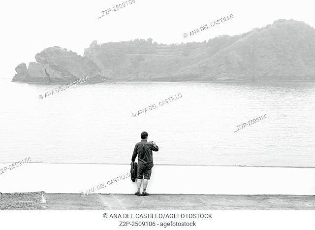 Man photographer in Vila Franca Sao Miguel island Azores Portugal