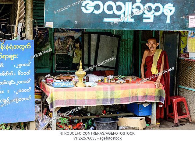 Monk in a shop around Mount Popa, Myanmar