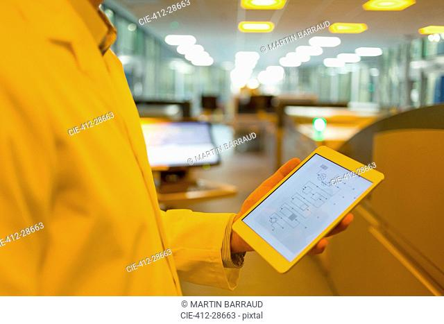 Engineer with digital tablet in factory
