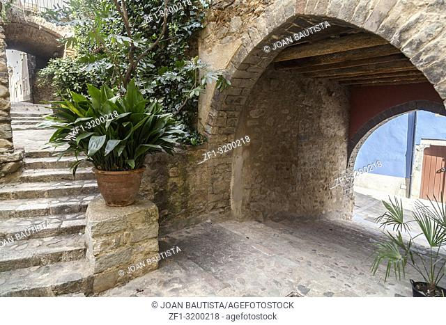 Ancient street view,carrer avall, of medieval village of Angles,province Girona,Catalonia