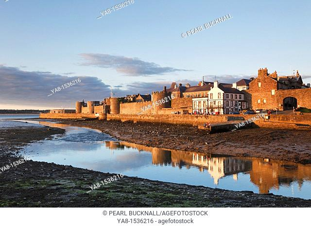 Caernarfon, Gwynedd, North Wales, UK, Britain, Europe  View of medieval town walls across Afon Seiont River flowing into the Menai Strait at low tide