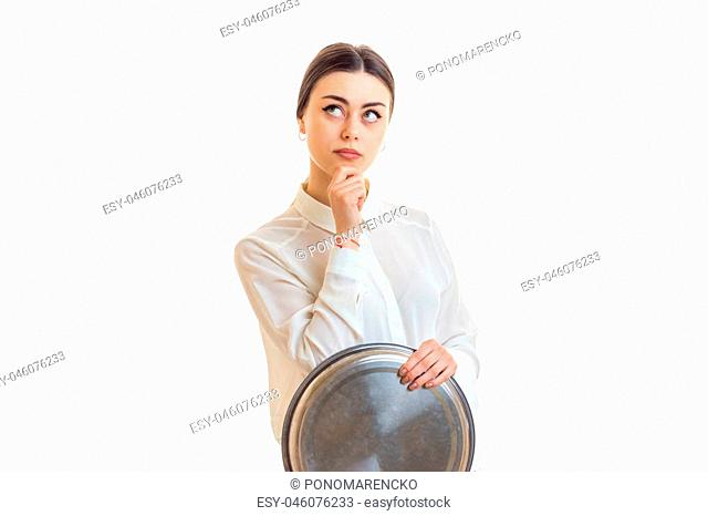 brooding young waitress with big round tray in hand isolated on white background