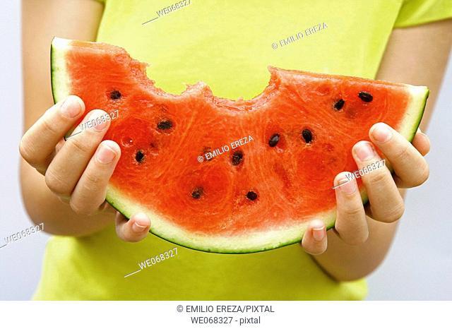 Woman holding watermelon
