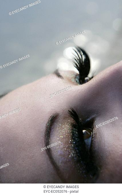 Close-up of a woman wearing false eyelashes