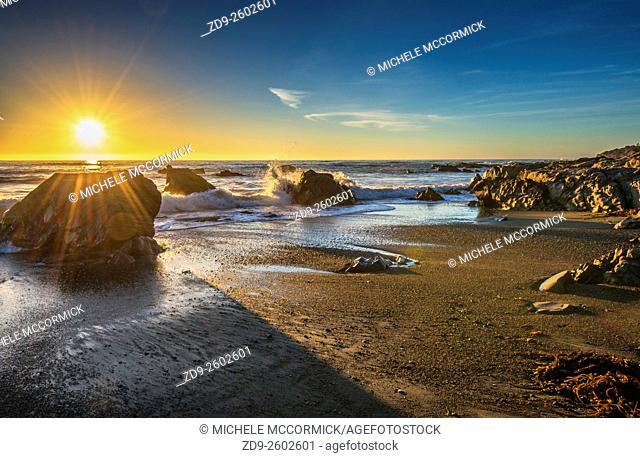 Sunset on the rocky coastline at Moonstone Bay