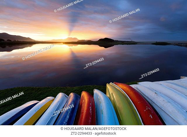 Landscape photo of canoes on a lagoon shore. Kleinmond, Western Cape, South Africa