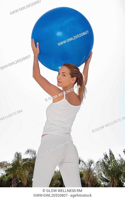 Woman holding a fitness ball