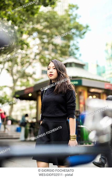 USA, New York City, Manhattan, portrait of young woman dressed in black