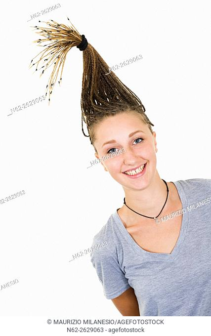 Smiling blond girl with pigtails vertically lift on her head
