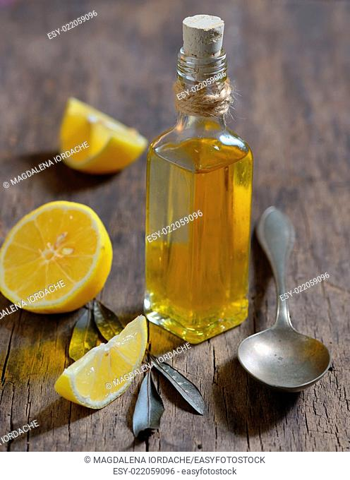 Liver Detox with olive oil and lemon fruits on the wooden table