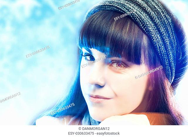 Young Sensual Brunette Woman Wearing Winter Hat Over Winter Cold Background. Horizontal Image Composition