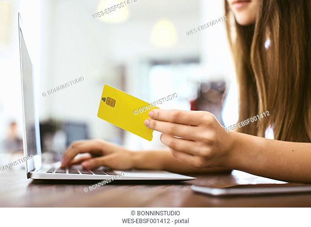 Young woman making online payment