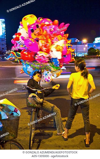 Balloon seller. Ho Chi Minh City (formerly Saigon). South Vietnam