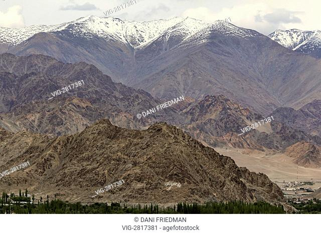 A Tibetan Buddhist prayer written on a mountainside just outside of the town of Leh in Ladakh, India. - LEH, LADAKH, INDIA, 12/07/2010