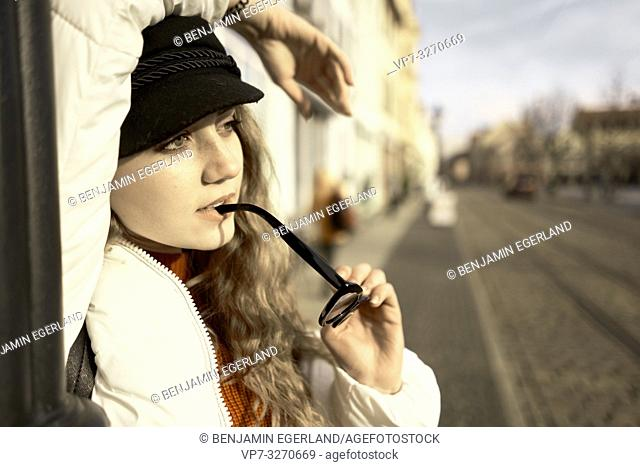 young thoughtful woman at street, in city Cottbus, Brandenburg, Germany