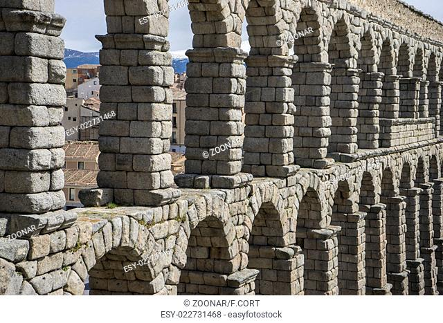 Tourist, Roman aqueduct of segovia. architectural monument declared patrimony of humanity and international interest by UNESCO