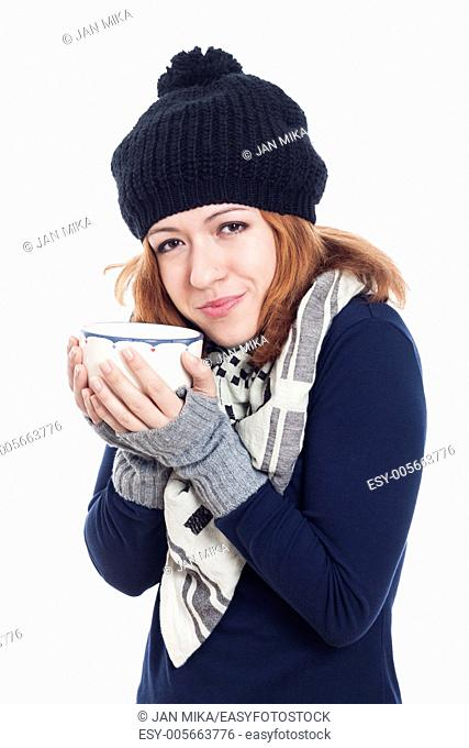 Happy woman in winter hat enjoying hot drink, isolated on white background