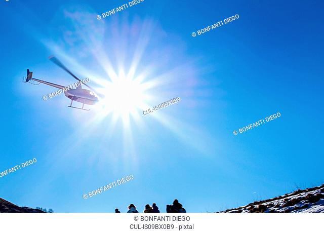 Helicopter flying over Piani Resinelli, Lombardy, Italy