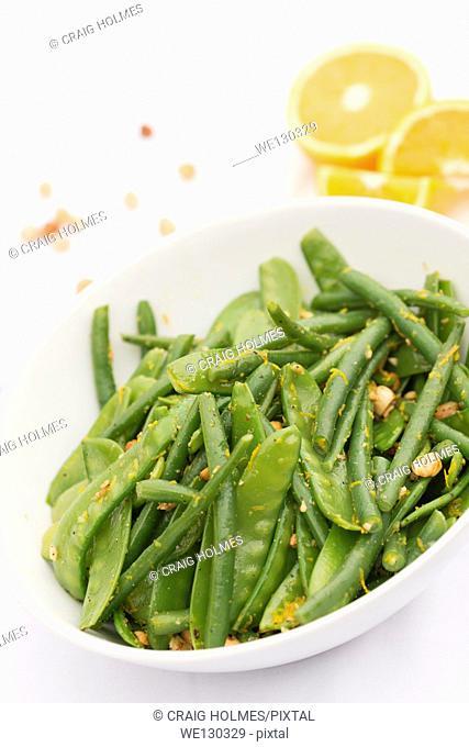 Green sweet pea, bean, hazelnut and orange salad