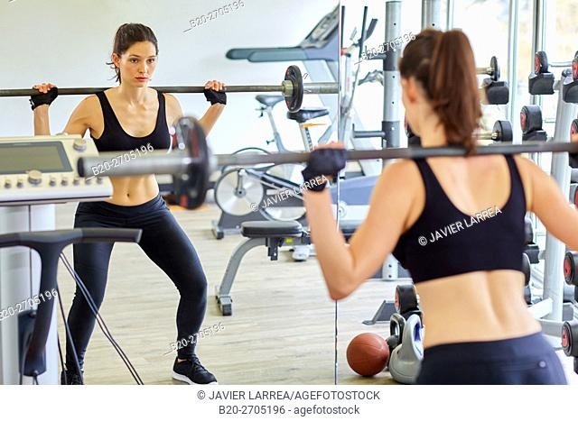 Dumbbells, Woman lifting weights at the gym