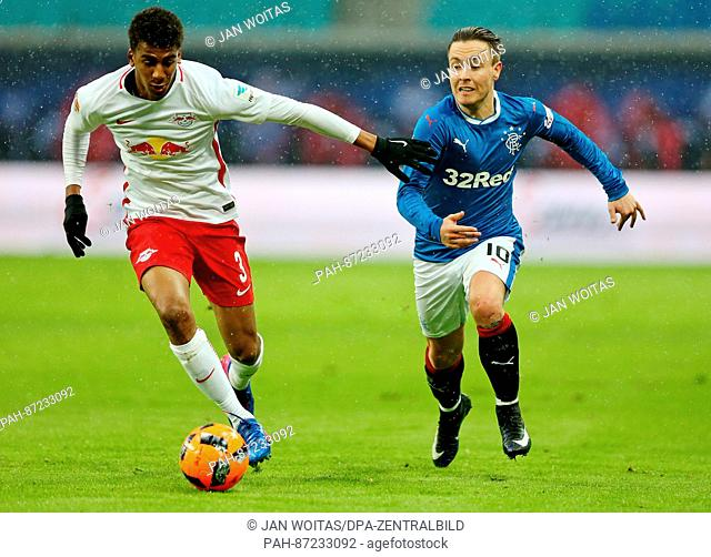 Glasgow's Barrie McKay (r) and Leipzig's Bernardo Fernandes da Silva in action during the soccer test match between RB Leipzig and Glasgow Rangers at the Red...