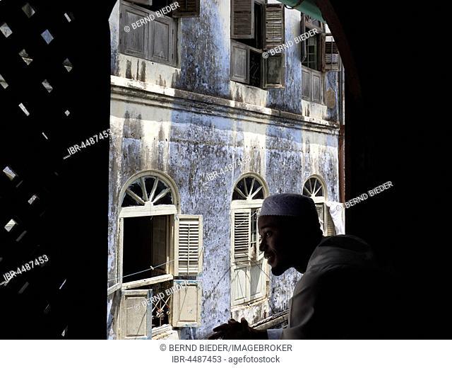 Arab man at the window, old alleyway, Stonetown, Zanzibar Archipelago, Tanzania