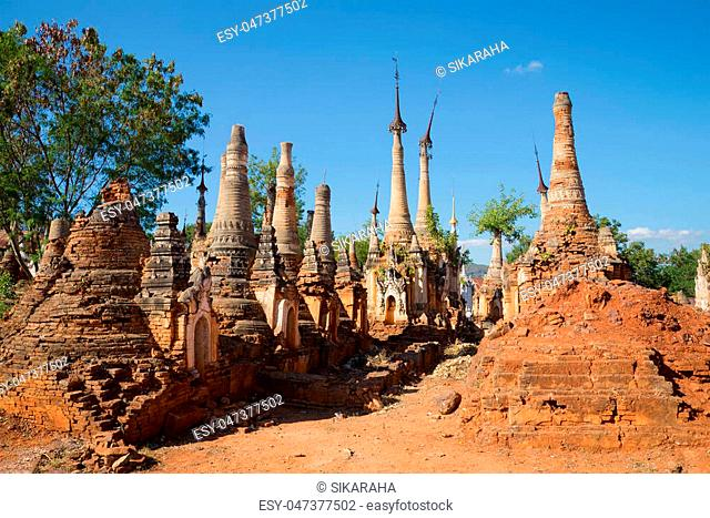 Ancient stupas of the Shwe In Dein pagoda. Sunny day. The surroundings of Inle lake, Myanmar